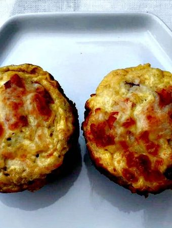 two quinoa omelet muffins on a white plate