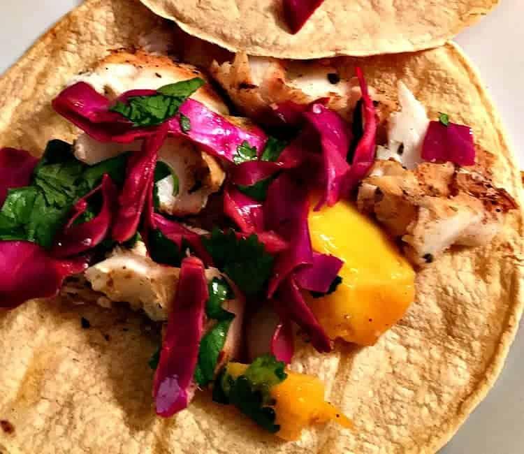close up of fish tacos with mango salsa