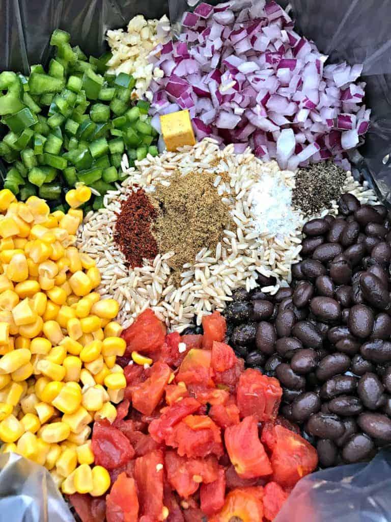 seasonings and veggies in a slow cooker