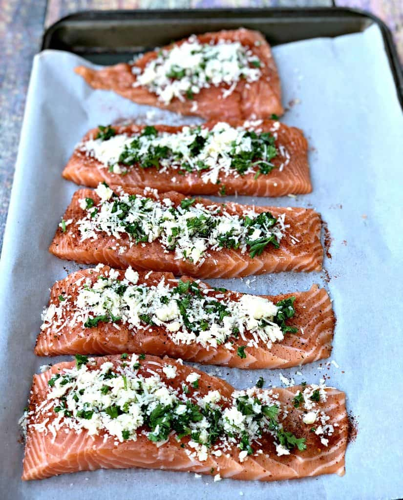 raw salmon sliced with herbs and cheese