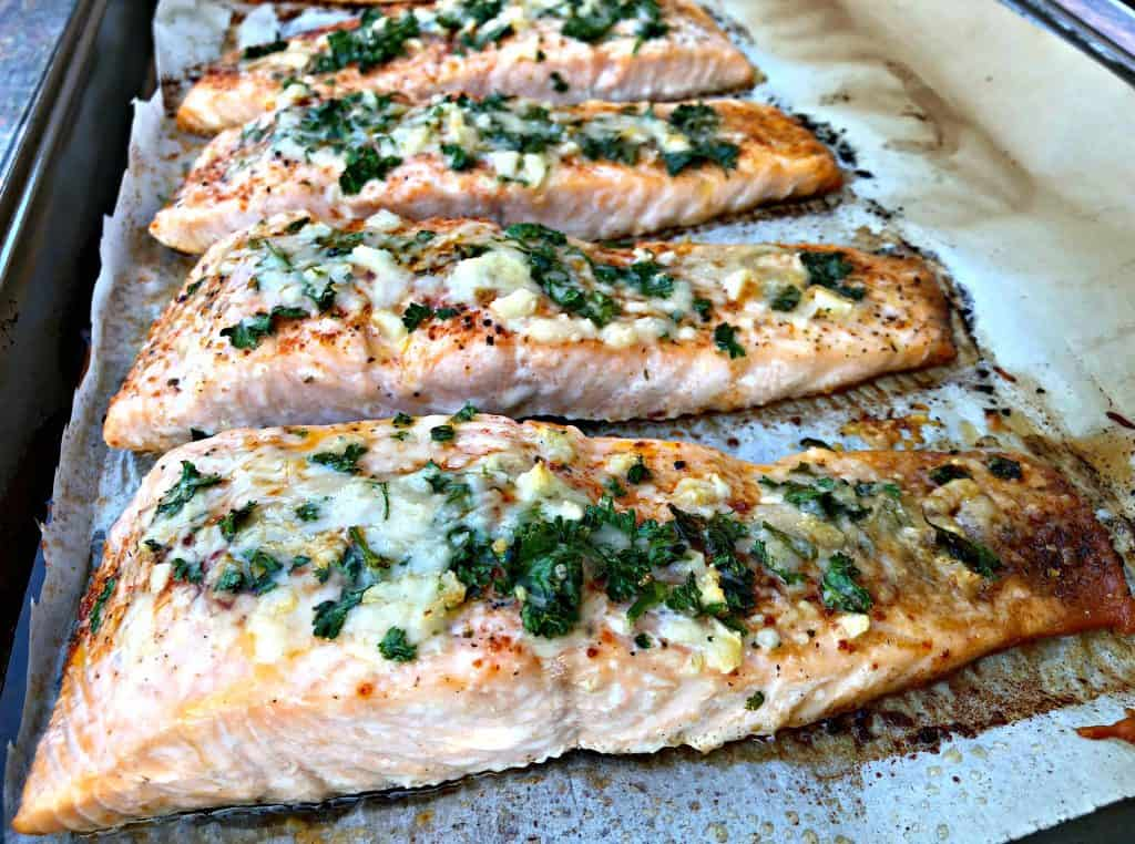 parmesan crusted salmon with herbs on a sheet pan
