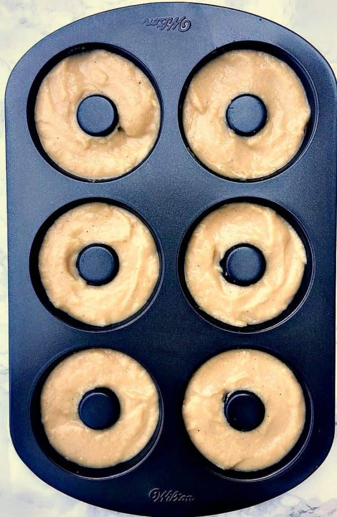 protein donut mix in a donut maker pan