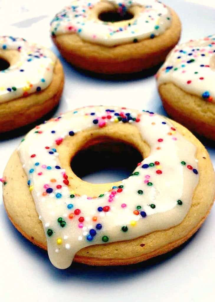protein donut with frosting and sprinkles on a white plate