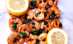 spicy smoky shrimp on a white surface