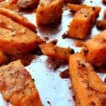 Parmesan Sweet Potatoes on a foil lined baking sheet