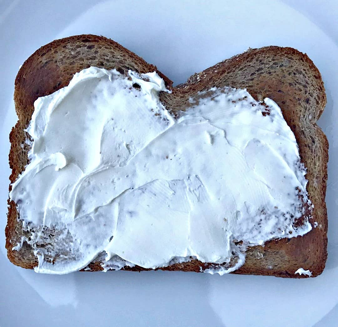 piece of toast with cream cheese spread