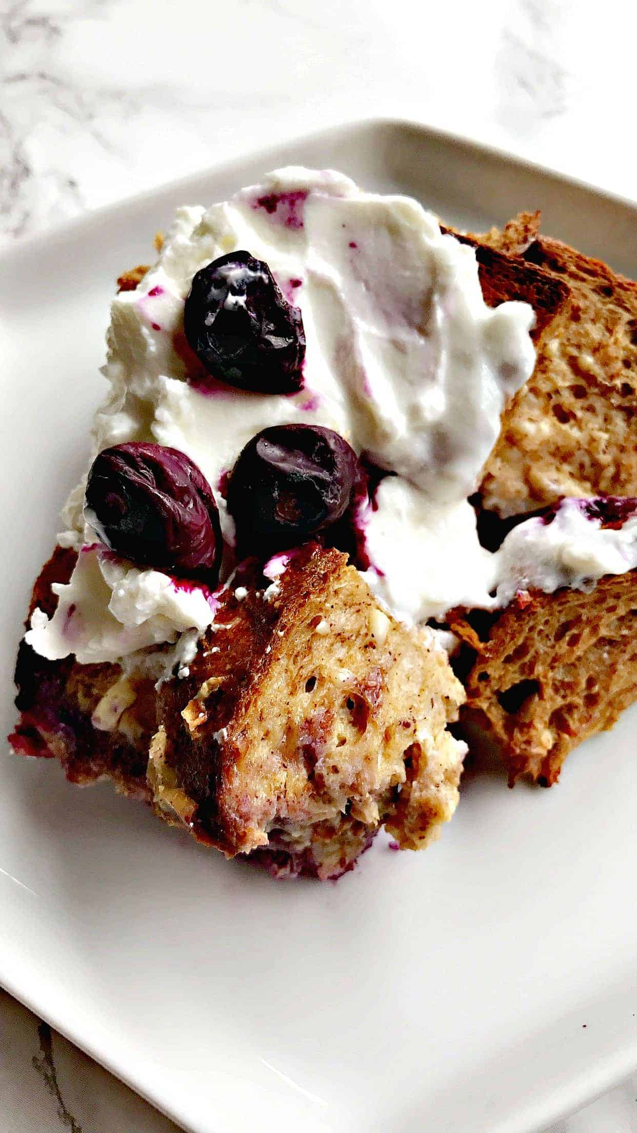 blueberry cream cheese french toast on a white plate