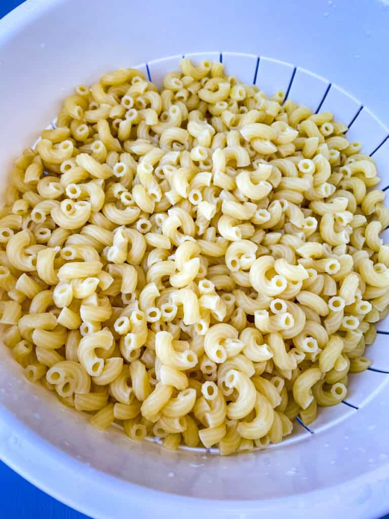cooked macaroni noodles in a white bowl