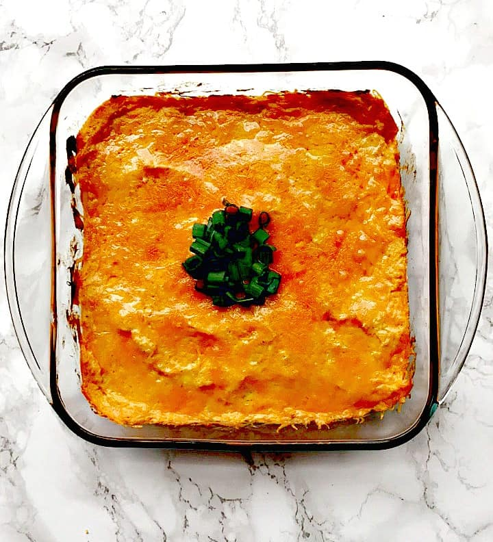 low carb buffalo chicken dip in a glass bowl