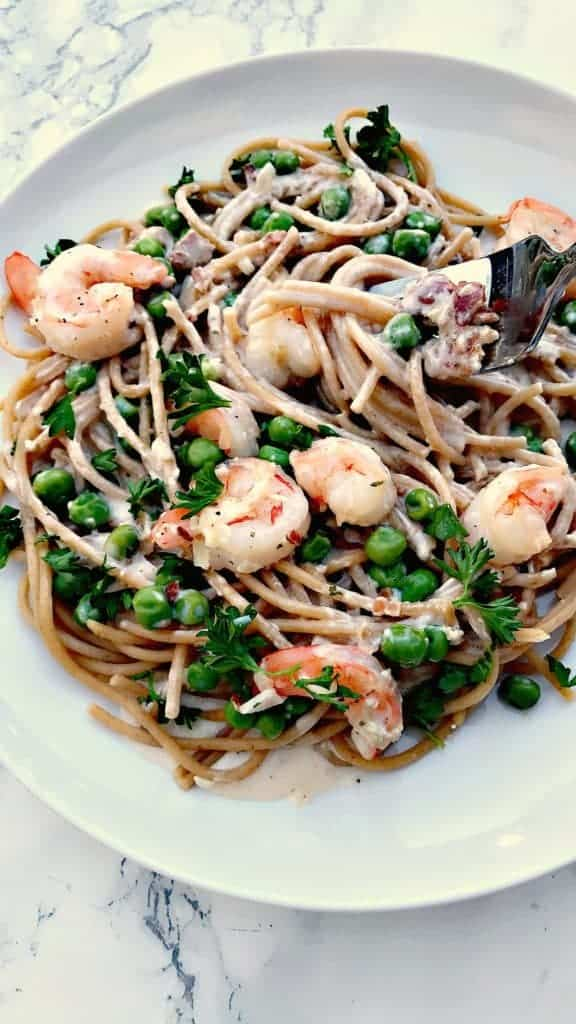 plated shrimp carbonara with whole wheat pasta