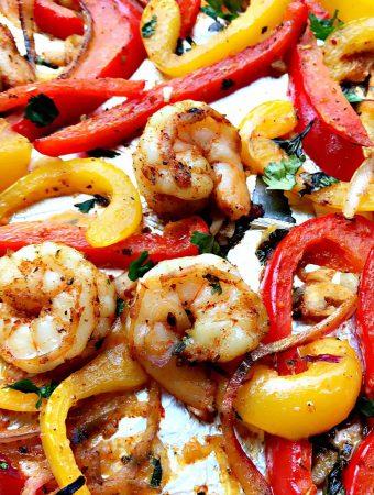 close up of shrimp fajitas on a baking sheet