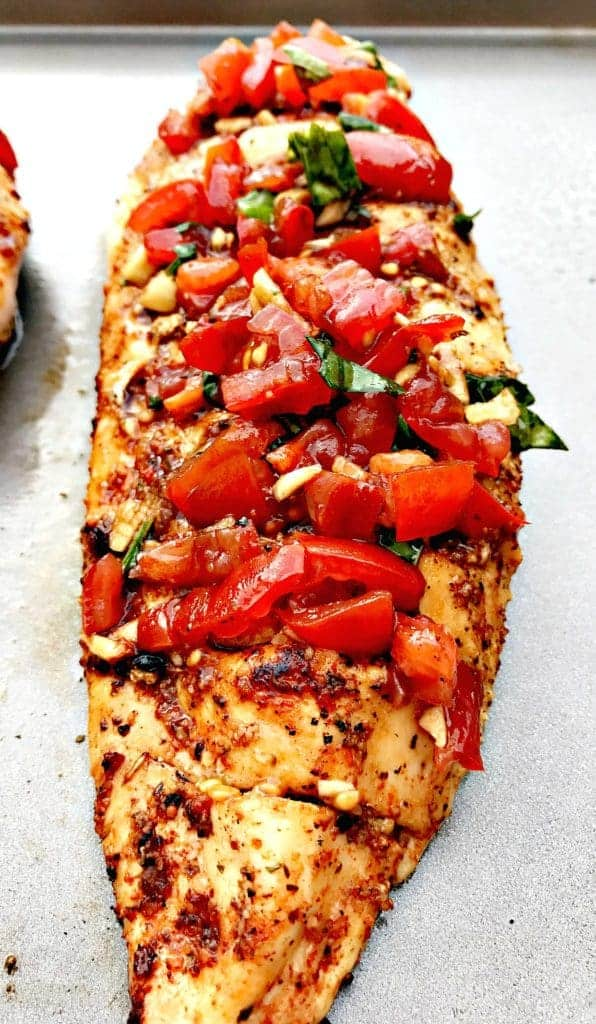 bruschetta stuffed chicken with tomatoes and vegetables