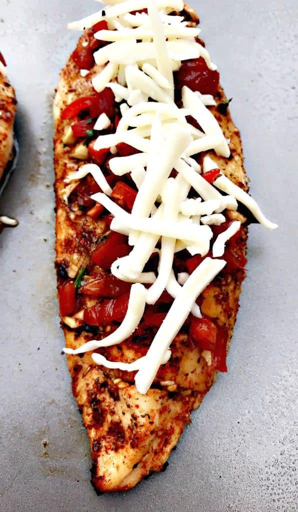 bruschetta stuffed chicken with shredded cheese