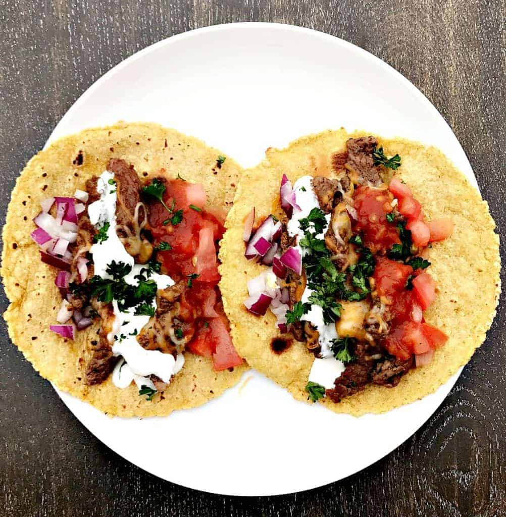 Instant Pot 10-Minute Steak Tacos (carne asada) on a white plate
