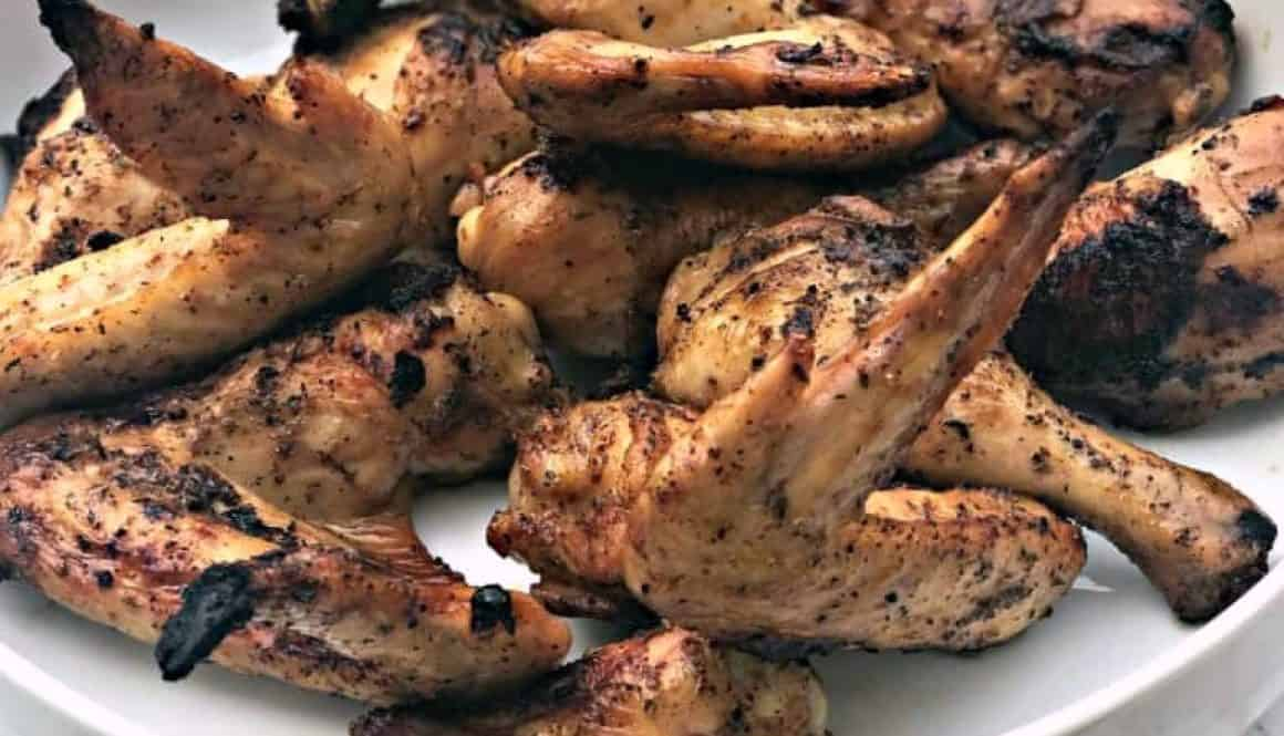 grilled bbq chicken wings in a large white bowl