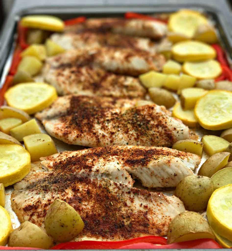 sheet pan tilapia avocado lime creama and roasted veggies