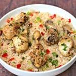 arroz con pollo chicken and rice in a white bowl