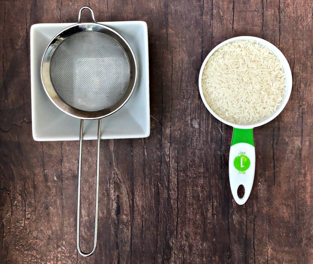 white rice and strainer