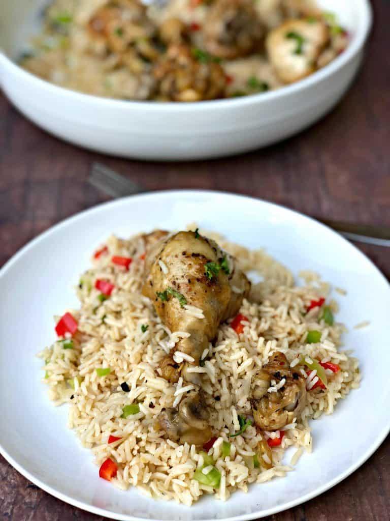 arroz con pollo in a white bowl