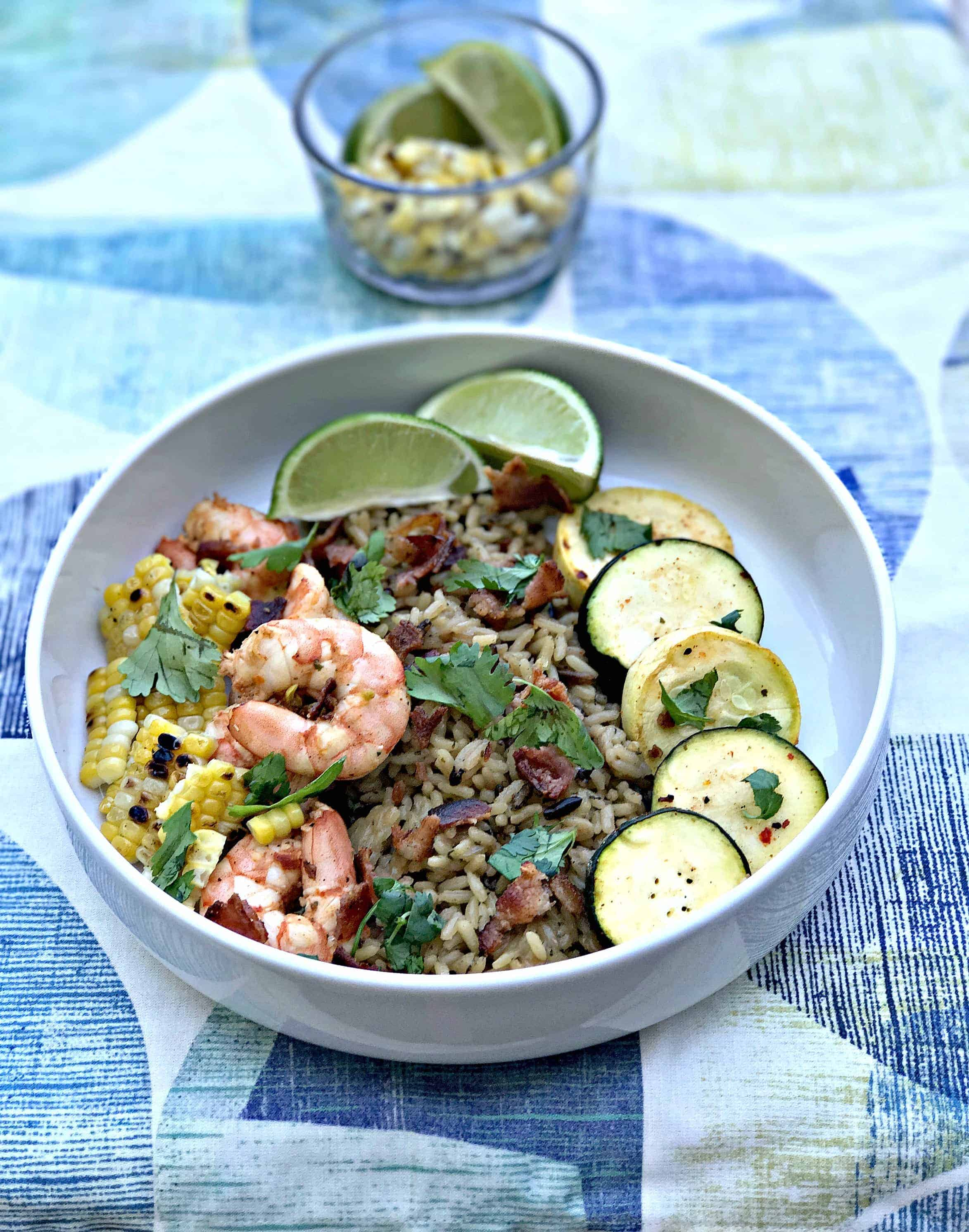 chipotle bacon bowl with grilled shrimp and veggies served in a white bowl