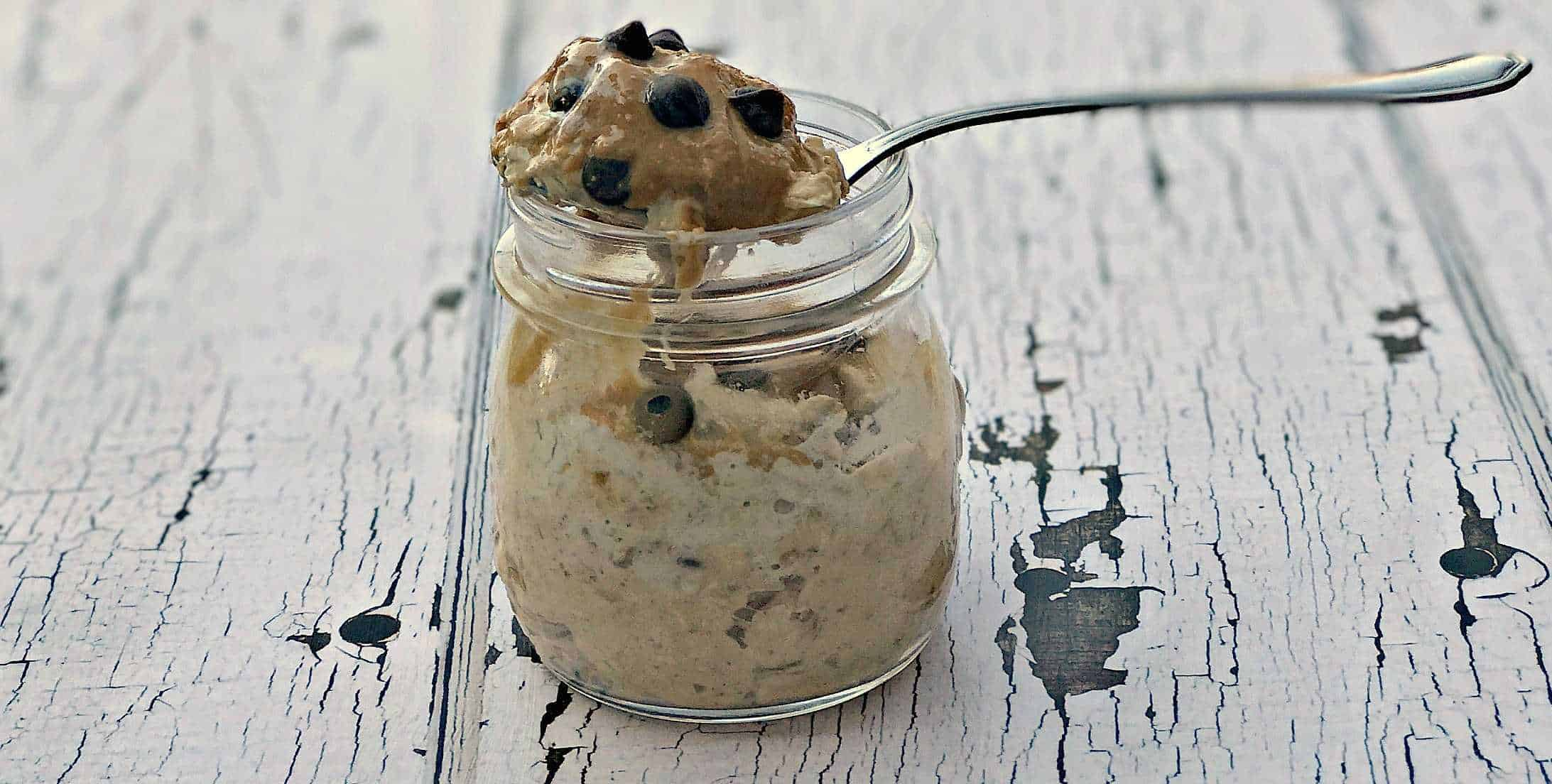 Chocolate Chip Cookie Dough Protein Overnight Oats in a glass jar