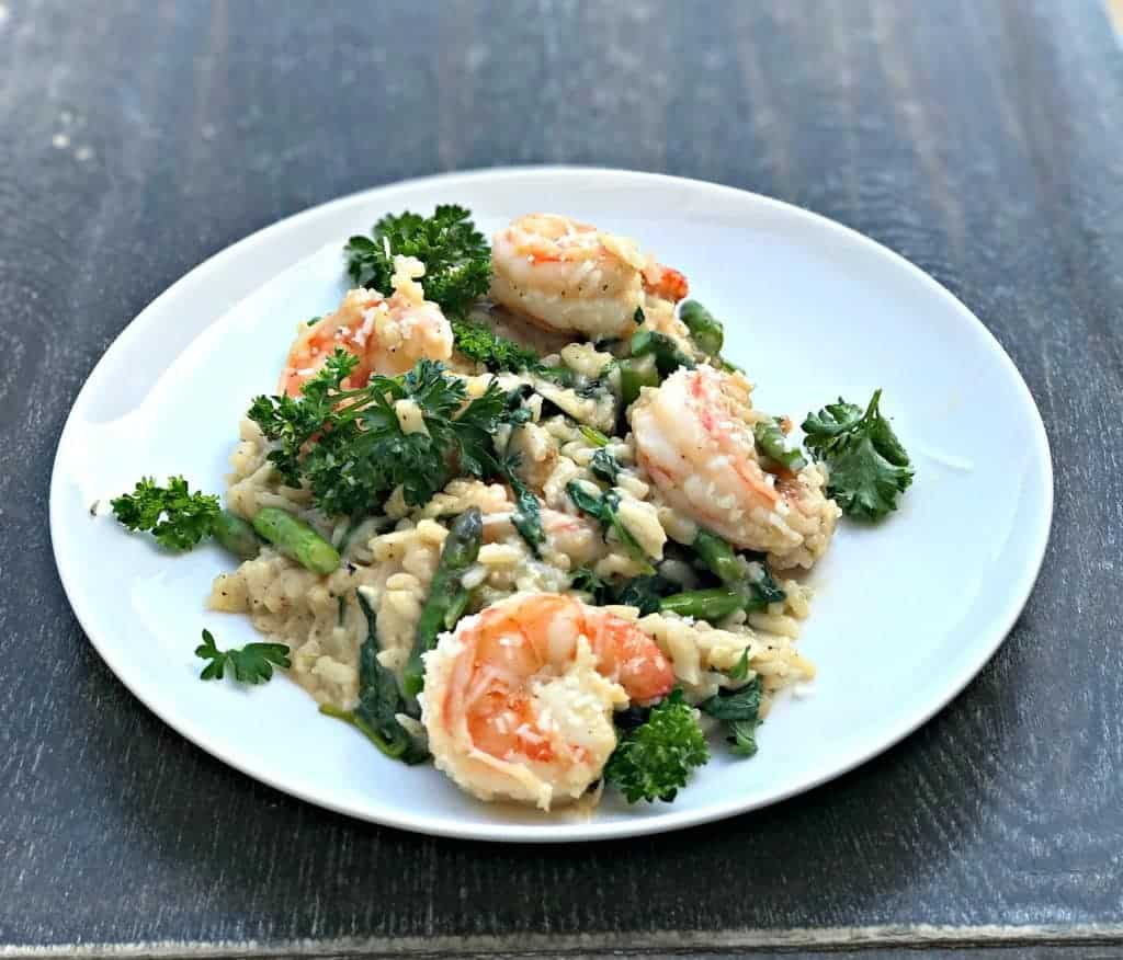 Instant Pot Lemon Shrimp Risotto with Vegetables and Parmesan on a white plate with parsley