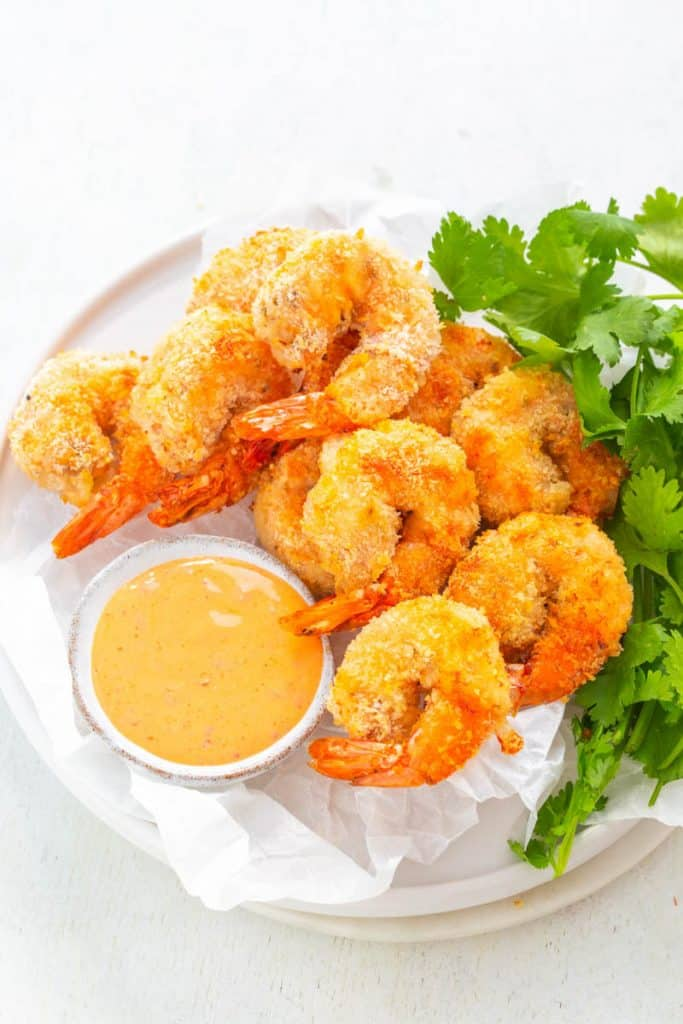 air fryer Bang Bang Panko Breaded Fried Shrimp on a white plate served with a spicy sweet chili sauce