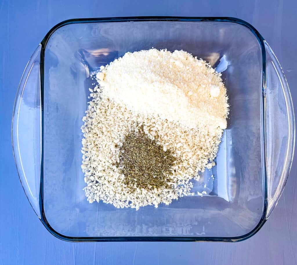 breadcrumbs, parmesan cheese, and Italian seasoning in a large glass bowl