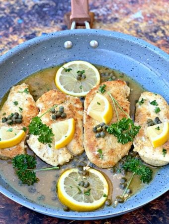 keto lemon chicken piccata in a skillet