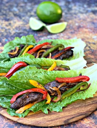 keto low carb steak fajitas on a lettuce wrap
