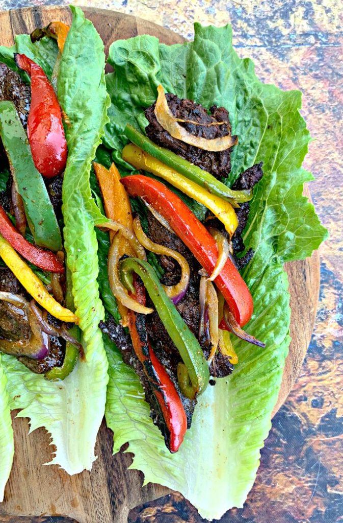 keto low carb steak fajitas on a lettuce wrap