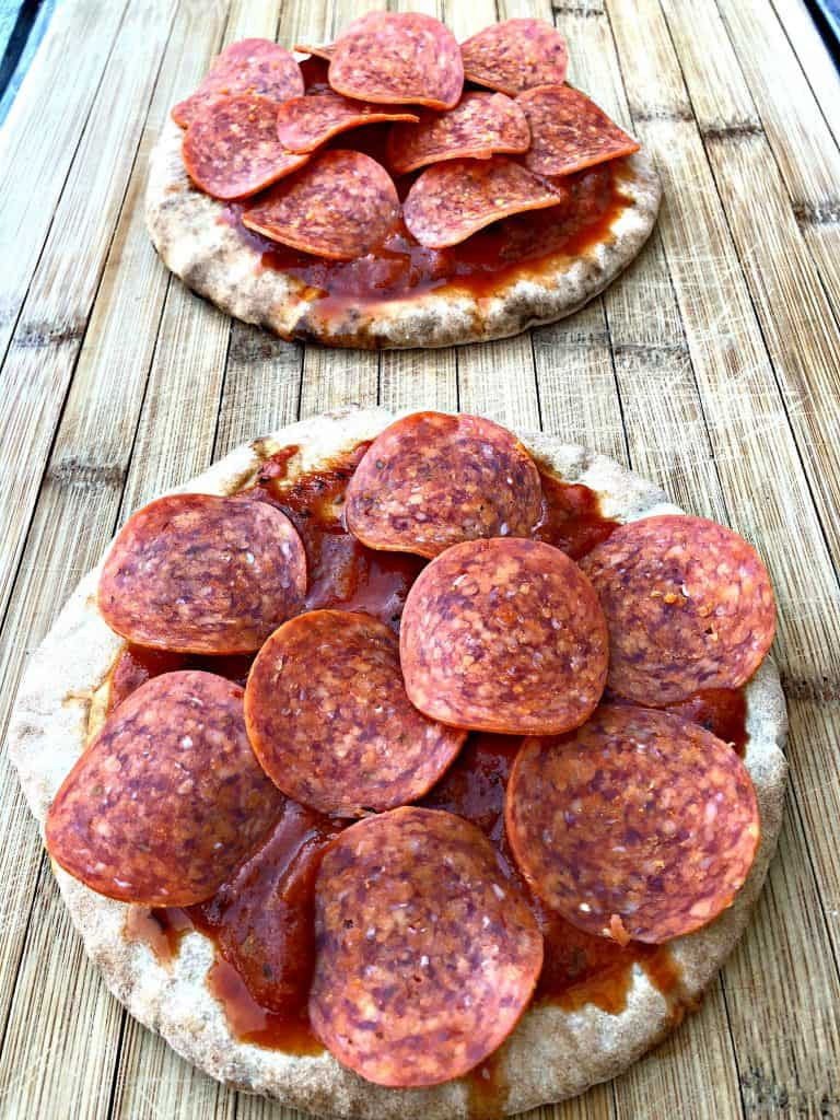 pita bread with pizza sauce, pepperoni