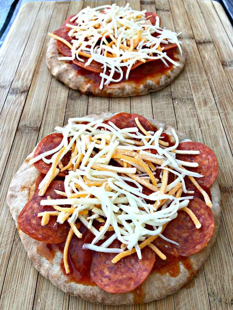 pita bread with pizza sauce, pepperoni, and cheese