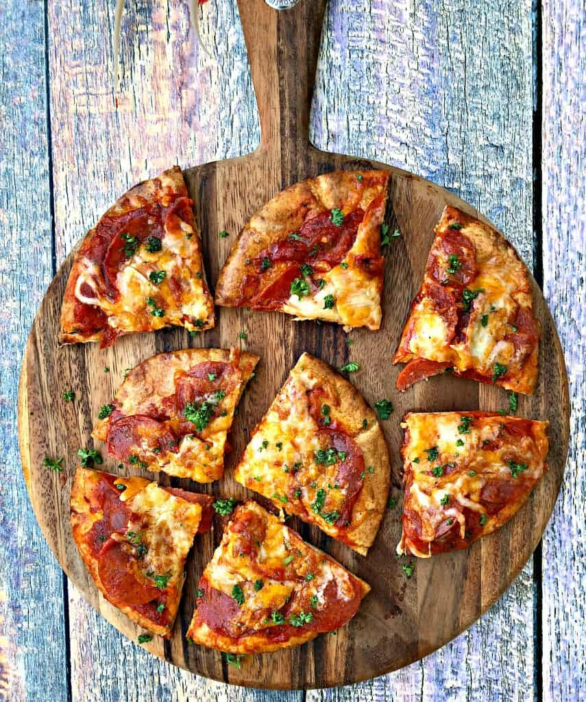 air fryer pepperoni pizza with mozzarella cheese in a multi colored surface