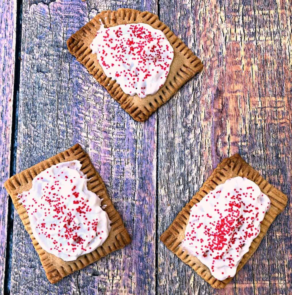 air fryer strawberry pop tarts on a multi color surface