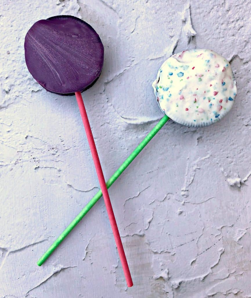 2 Oreo Dessert Pops on a flat surface