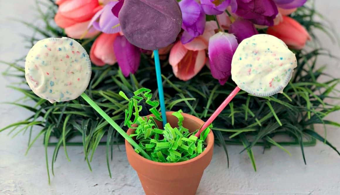 Easy 3 Ingredient Oreo Dessert Pops in a pail with Easter grass