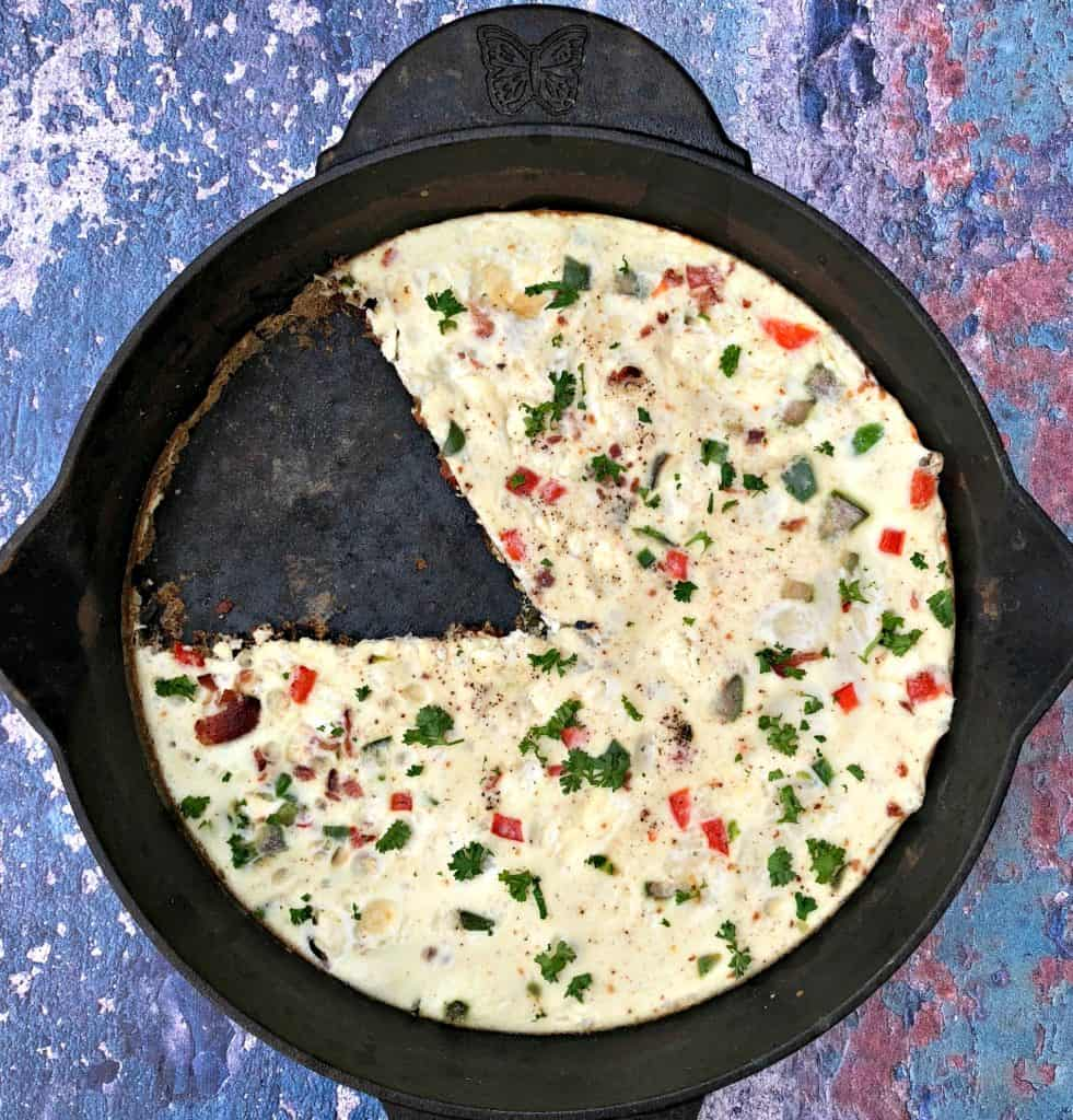 Post-Workout Egg White and Bacon Frittata Protein Recipe in a black cast iron skillet