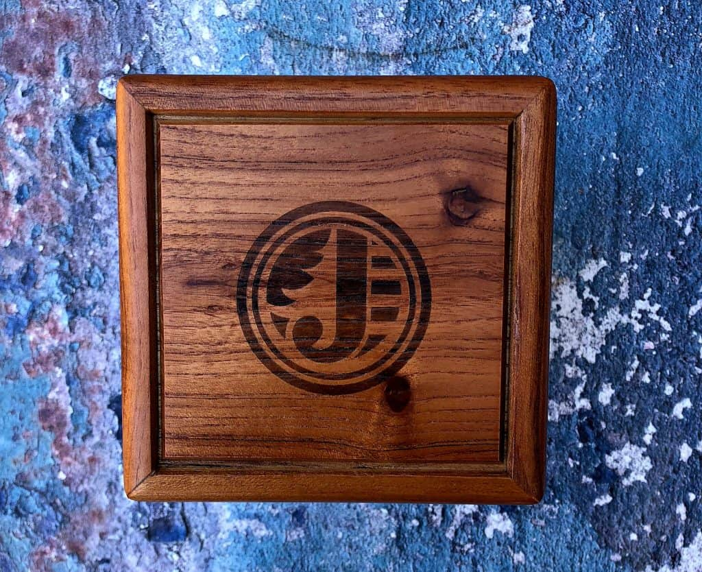 wooden box with the letter J in the middle
