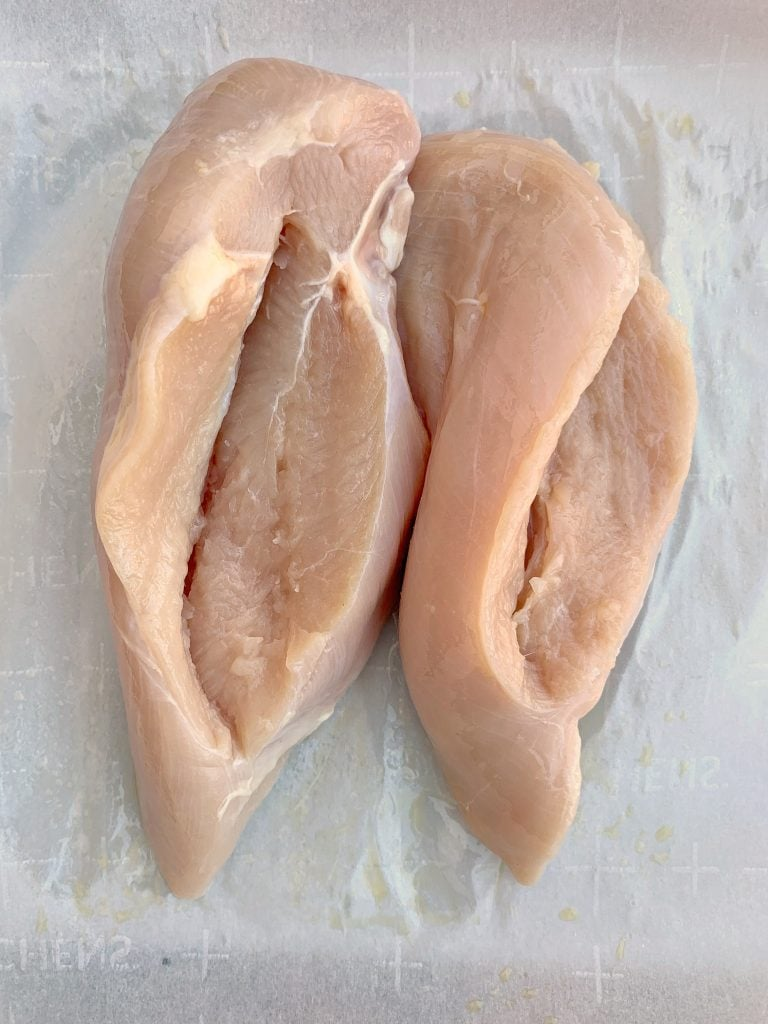 raw chicken breasts sliced with side pockets