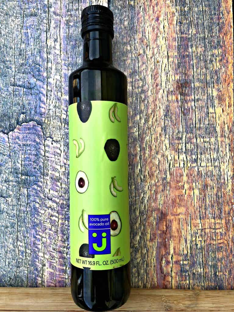 avocado oil bottle on a multi color surface