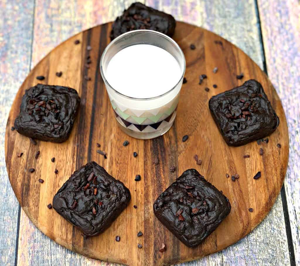 avocado brownies with milk on a brown cutting board