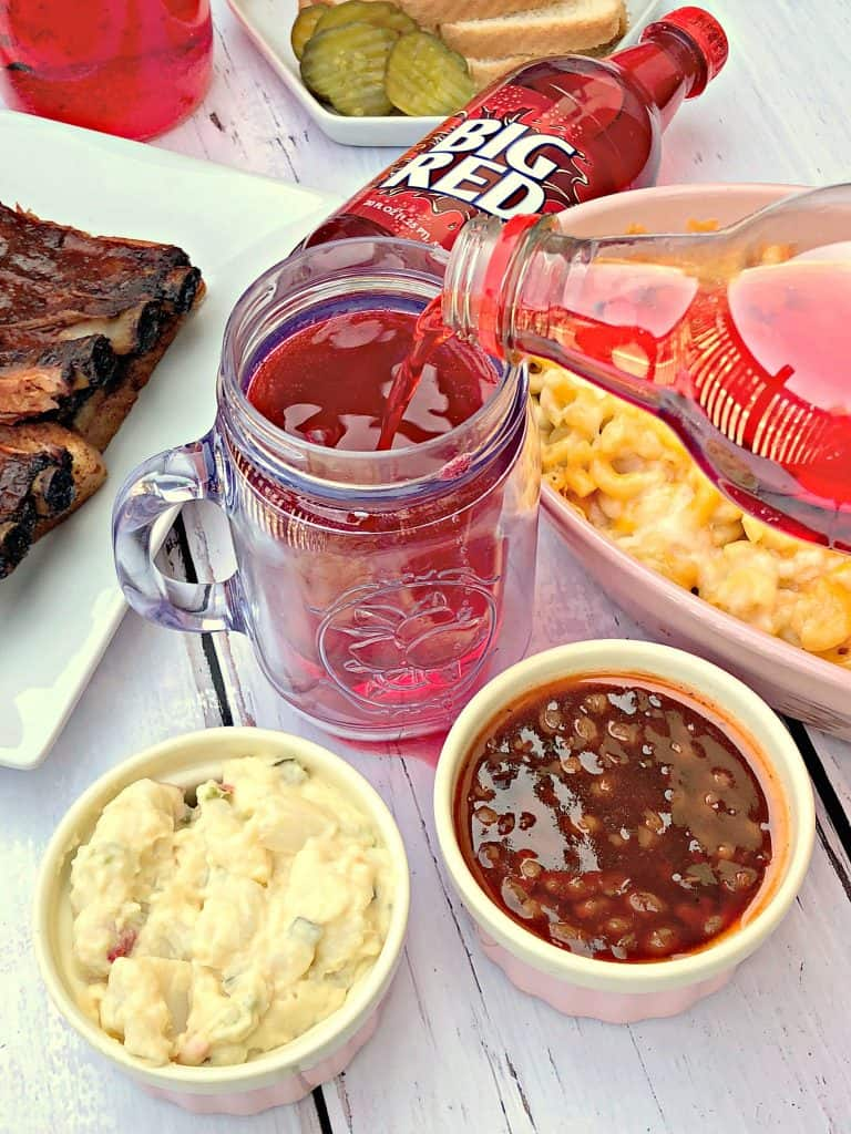 mac and cheese, red soda, with side dishes
