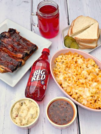 mac and cheese, ribs, red soda, with side dishes