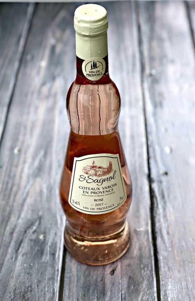 rose' wine on a dark surface