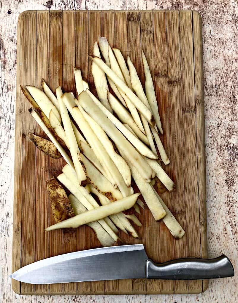 raw potatoes sliced like fries