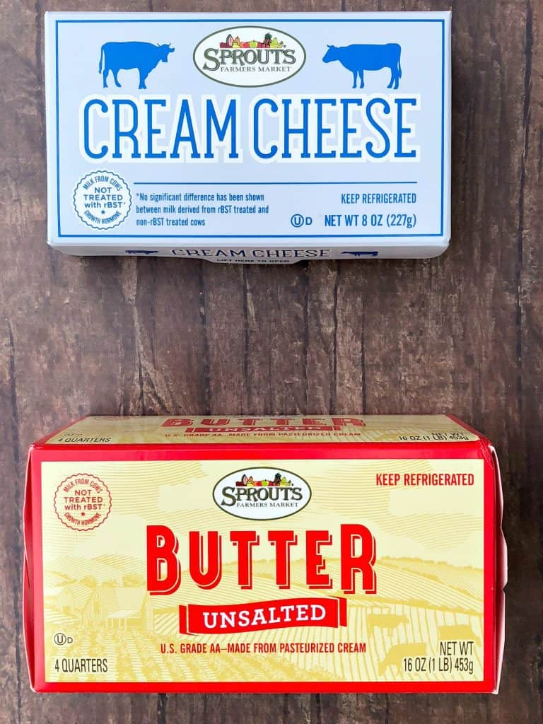 packages of butter and cream cheese on a flat surface