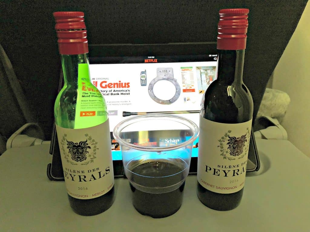 red wine served on a plane with an ipad