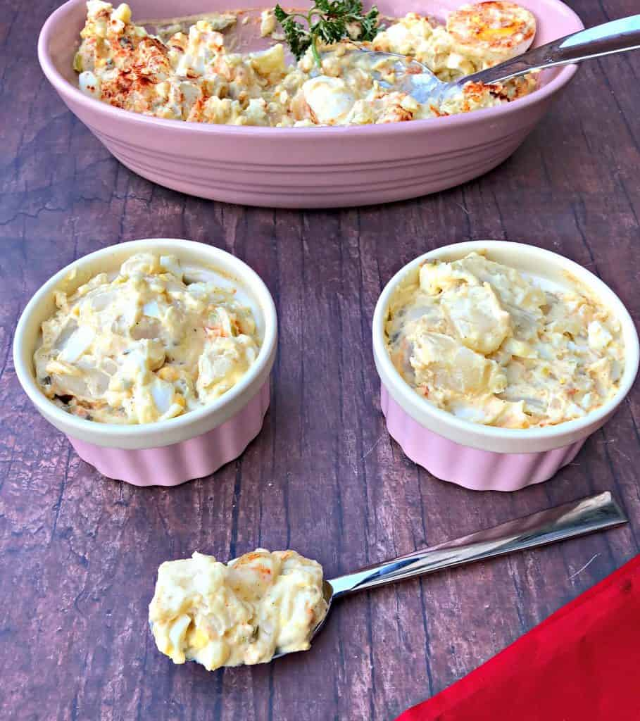 instant pot potato salad with boiled eggs in a pink bowl