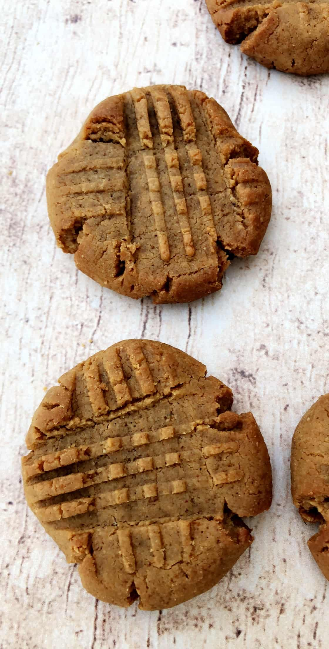 2 keto peanut butter cookies on a flat surface